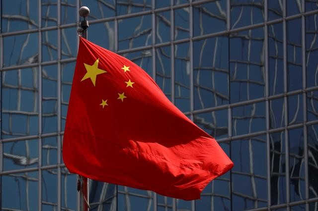 China reports 130 new Covid-19 cases, state media warns against 'crying wolf'